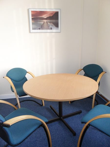 Small meeting room – seats up to 6 people.